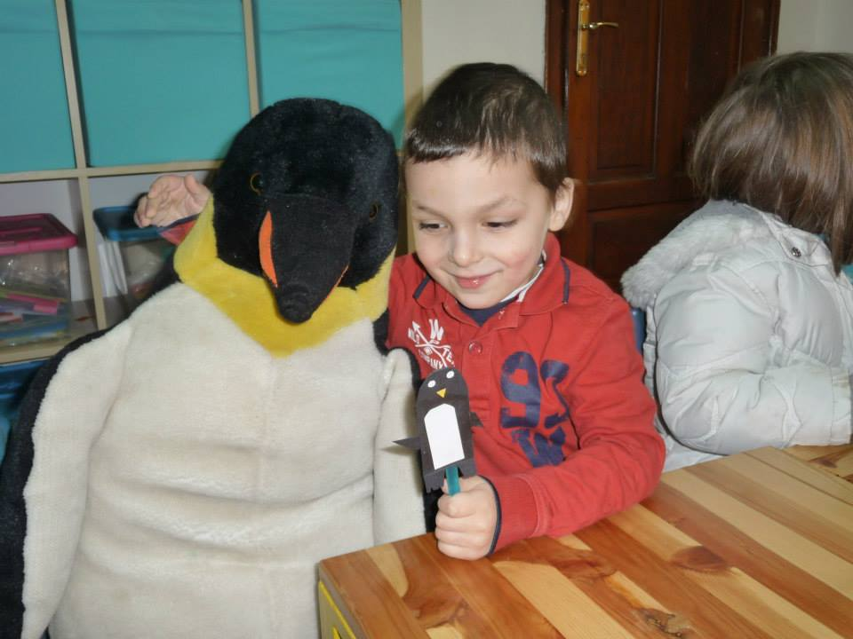 "One child is having his penguin puppet converse with Bob's cousin ""Ed""."